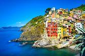 Riomaggiore Village, Rocks And Sea At Sunset. Cinque Terre, Ligury, Italy
