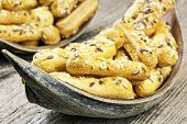 Biscuits with caraway seeds on wooden table