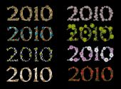 Collection Of 2010 New Year Emblems On Black