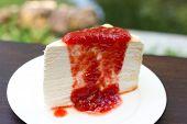 Strawberry crepe cake on white dish.