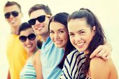 summer, holidays, vacation, happy people concept - group of friends having fun on the beach poster