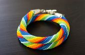 Knitted Necklace From Beads Of A Rainbow Colors