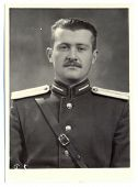 antique photo shows portrait of a Soviet Army lieutenant in uniform