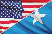 Series Of Ruffled Flags. Usa And Federal Republic Of Somalia.
