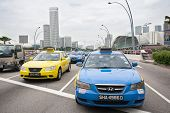 SINGAPORE - NOVEMBER 05, 2012: Taxi on the Esplanade Drive. In Singapore more than 25 thousand cars