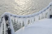 View of Baikal and icicle-covered fence