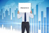 Businessman holding card saying presence against global business graphic in blue