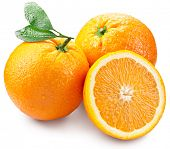 Oranges with slice and leaves isolated on a white background. Image with a maximum depth of field.