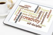 creativity, self-discipline and other personal qualities - a word cloud on a digital tablet with cup of coffee