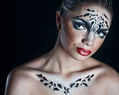 stock photo of snow-leopard  - Attractive young girl with make - JPG