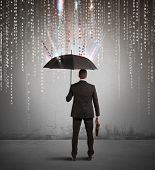 stock photo of antivirus  - Antivirus and firewall concept with businessman protected with umbrella - JPG
