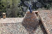 image of conic  - Conical chimney on a medieval tiled rooftop in Calatanazor Spain - JPG