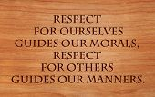 Respect for ourselves guides our morals, respect for others guides our manners - quote by Laurence Sterne on wooden red oak background