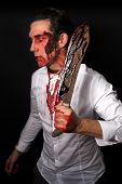 stock photo of bloody  - Psychopath with bloody knive in a white shirt - JPG