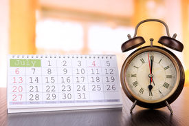 pic of countdown timer  - Alarm clock  and calendar on bright background - JPG
