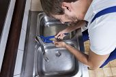 Man Repairing Washbasin Tap