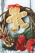 Composition of ginger bread and Christmas wreath