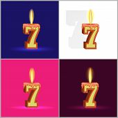 the number seven in the form of a burning candle