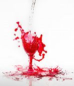 Red Water Spill From A Broken Wine Glass On A White Background