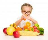 little girl with fruits and vegetables make juice