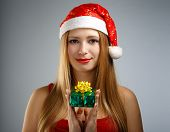Young Woman In Santa Hat With Christmas Gift Box