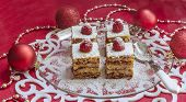 Holiday Apple Pie Bars, Garnished With Fresh Raspberries And Christmas Decorations.