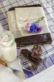 Chocolate Tart With Halva, Decorated With Cornflowers, Near Bottle Of Milk
