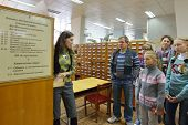 NOVOSIBIRSK, RUSSIA - OCTOBER 5, 2014: Library staff demonstrate the old card catalog to the public during the 4th Science Festival. The event aimed to popularize science
