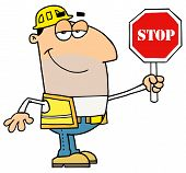 Friendly Male Caucasian Traffic Director Holding A Stop Sign