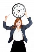 Asian Businesswoman Point To Clock Over Head