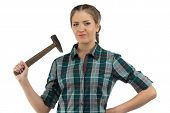Photo of young woman with hammer