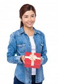 Asian woman hold with red gift box