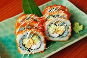 stock photo of masago  - California Maki Sushi with Masago - Roll made of Crab Meat Avocado Cucumber inside.
