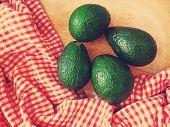 Fresh avocado on wooden desk
