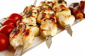 image of kebab  - fresh roast chicken shish kebab on white platter - JPG
