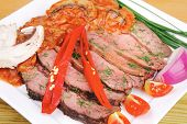 hot beef on plate over wooden table
