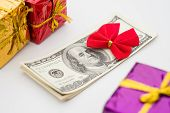Stack Of Dollars With Red Bow And Gift Boxes