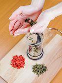 Woman strewing green tea