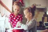 5 years old twins cooking holiday pie in the kitchen, casual lifestyle photo series in real life interior