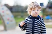 Portrait Of Toddler Boy Having Fun On Outdoor Playground