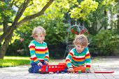 Two Boy Friends Playing With Red School Bus