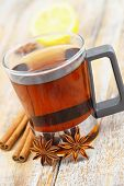 Glass of tea, star anise, cinnamon and lemon