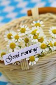 Good morning card with chamomile flowers in wicker basket