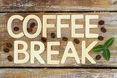 Coffee break written with wooden letters on rustic wooden surface