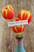 Happy Anniversary card with red and yellow tulips