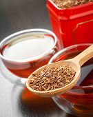Rooibos In Wooden Spoon Closeup, Two Tea Cups And Tea Tin Box
