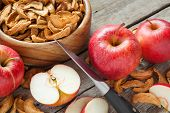 Dried Apple Slices And Fresh Apple Fruit On Table