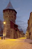 Medieval Tower And Defense Wall In Town Sibiu Winter By Dusk poster