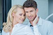Close up Middle Age Sweet Pretty and Handsome Couple on White Attire for Fashion Shoot. Outdoor Capt