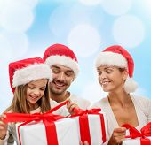 family, christmas, generation, holidays and people concept - happy family in santa helper hats with